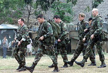 U.S. Green Beret soldiers walk inside the 103rd Philippine army brigade camp near Isabela, capital of the southern island of Basilan.
