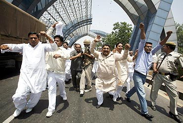 Farmers shout slogans during a protest march at Noida