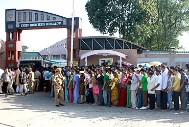 Supporters stand in a queue to pay their respects to the body of Dorjee Khandu