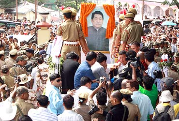 Supporters follow the body of Dorjee Khandu
