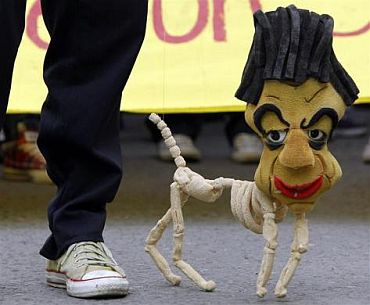 A student performs with a marionette effigy of Colombian President Juan Manuel Santos during a protest in Bogota. Thousands of students and teachers marched in a nation wide protest against the education government's reform of public universities, student organizations reported