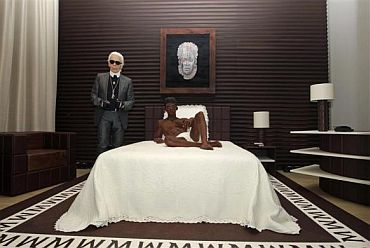 German designer Karl Lagerfeld poses as he unveils his hotel suite creation made of chocolate, part of a campaign by a leading ice cream brand, at a hotel in Paris