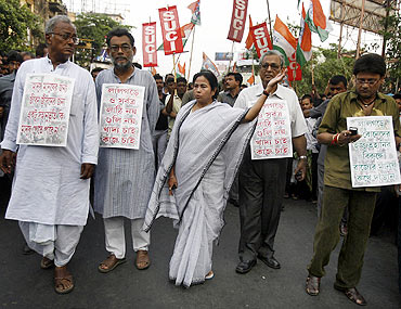 Mamata Banerjee takes part in a rally to protest against the government's actions in Lalgarh