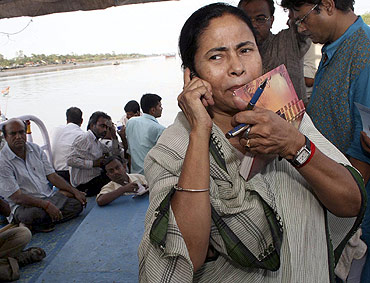A file photo of Mamata Banerjee during her visit to a cyclone-devastated site in Sunderbans