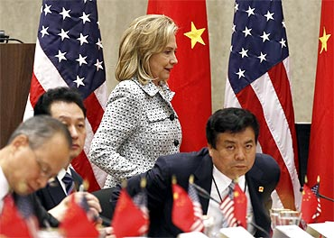 Hillary Clinton walks past the Chinese delegations