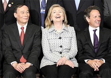 China's Vice Premier Wang Qishan (L-R), US Secretary of State Hillary Clinton and US Treasury Secretary Timothy Geithner gather for a portrait