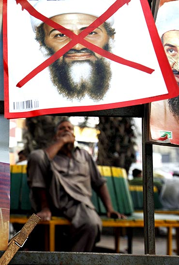 A newspaper stand displays magazines with pictures of Al Qaeda's Osama bin Laden