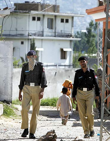 Policemen patrol a street near the compound where Osama bin Laden was killed in Abbottabad