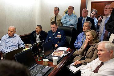 US President Barack Obama and Vice President Joe Biden, Secretary of State Hillary Clinton, Defence Secretary Robert Gates along with members of the national security team, receive an update on the mission against Osama bin Laden in the Situation Room of the White House on May 1
