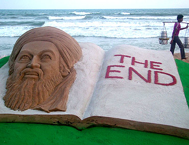 A sand sculpture of Al Qaeda leader Osama bin Laden created by sand artist Sudarshan Patnaik on a beach in Puri