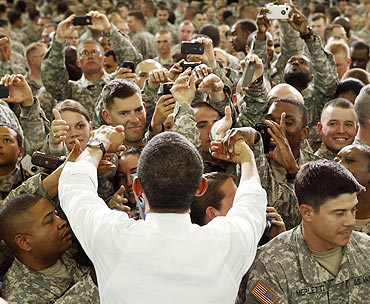 US President Barack Obama greets troops at Fort Campbell in Kentucky. He thanked some members of the elite special forces team involved in the raid that killed Osama bin Laden.