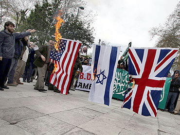 Demonstrators set fire to flags of US, Israel and Britain following a special prayer for Al Qaeda leader Osama bin Laden