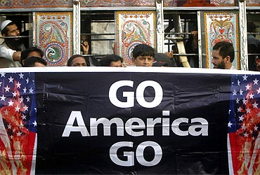 Supporters of Jamaat-e-Islami hold a banner during an anti-American rally