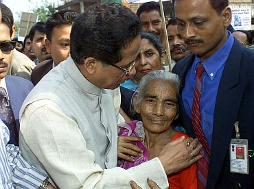 Gogoi consoles an elderly woman in Guwahati