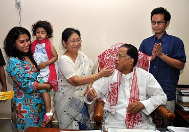 Tarun Gogoi celebrates with family after Friday's victory