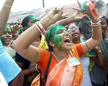 Trinamool supporters celebrate outside Mamata Banerjee's house in Kolkata