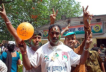 Trinamool supporters show the victory sign in Kolkata