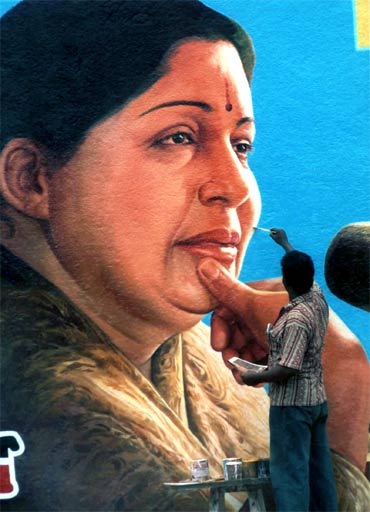 An artist applies the finishing touches to the portrait of Jayalalithaa