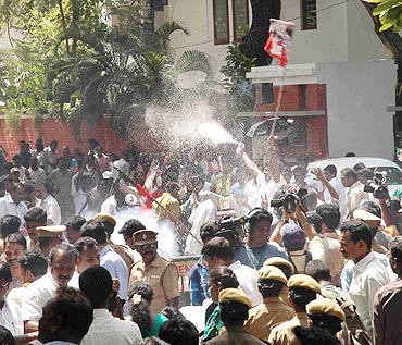 A file photo of partymen outside Jayalalitha's residence in Chennai
