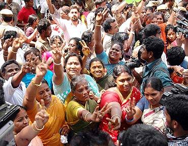 AIADMK women supporters show the victory sign