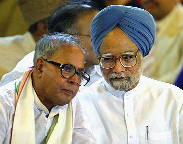 PM Manmohan Singh with Pranab Mukherjee at a gathering in New Delhi