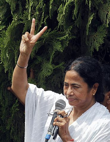Mamata Banerjee waves to supporters after Trinamool defeated Left front government, in Kolkata on Friday