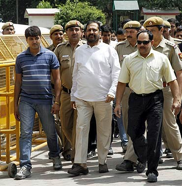 Suresh Kalmadi, former chief organiser of theCommonwealth Games, arrives at a court in New Delhi