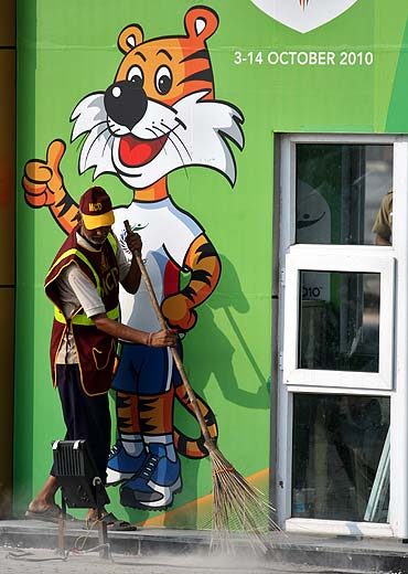 File photo of a cleaner at the Games village in New Delhi