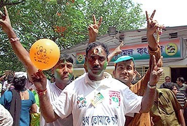 Trinamool Congress supporters celebrate after their party won the assembly elections in West Bengal