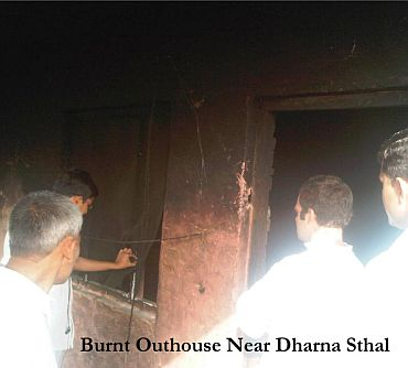 Rahul at a burnt down house near the protest spot