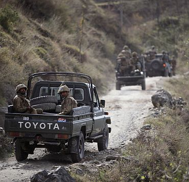 Pakistani army soldiers patrol in Swat valley region located in Pakistan's restive North West Frontier Province