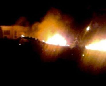 The compound, within which al Qaeda leader Osama bin Laden was killed, is seen in flames after it was attacked in Abbottabad in this still image taken from video footage from a mobile phone