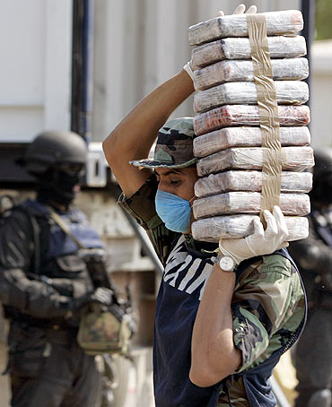 A marine carries packs of cocaine at a naval base in Manzanillo. The Mexican government said it belonged to drug lord Joaquin 'Shorty' Guzman