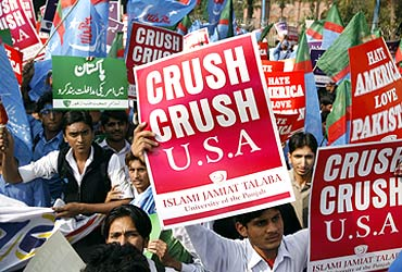 Students hold up anti-American placards during a rally in Lahore