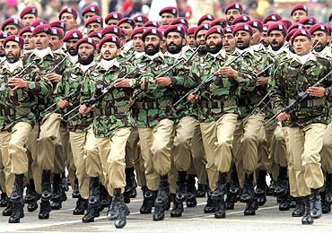 Pakistani army commandos participate in the National Day parade in Islamabad
