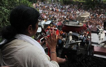 Banerjee waves to crowds from Writers' Building