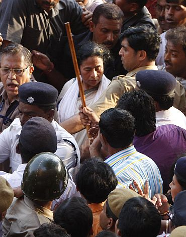Police try to keep crowds at bay as Banerjee walks to Writer's Building