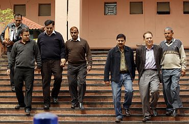 Lalit Bhanot and V K Verma accompanied by officials, leave CBI headquarters in New Delhi