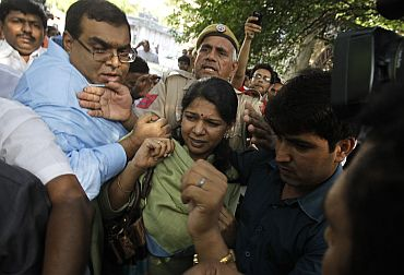 File image of Kanimozhi leaving a court in New Delhi