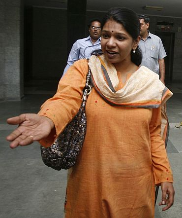 Kanimozhi and Sharad Kumar depart for court from their residence in New Delhi