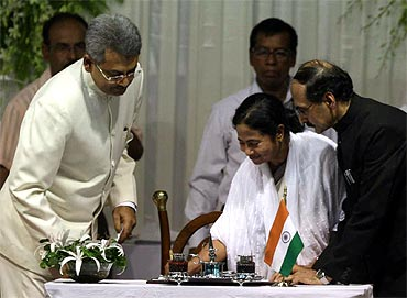 Mamata Banerjee signs the ministers' register after taking oath as Bengal CM