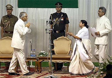 Mamata Banerjee is greeted by West Bengal Governor M K Narayanan