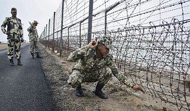 BSF soldiers patrol along the border with Pakistan in Banaskanth district, Gujarat
