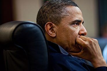 US President Barack Obama listens during one in a series of meetings discussing the mission against Osama bin Laden, in the Situation Room of the White House