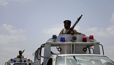 Paramilitary forces leave the Mehran naval aviation base after troops ended operations against militants in Karachi