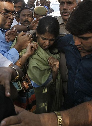 File photo shows Kanimozhi leaving a court in New Delhi