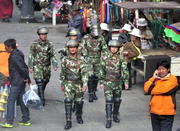 Armed paramilitary personnel patrol a street near Jokhang temple in Lhasa, Tibet