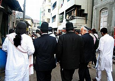 Jewish leaders from Israel and New York walk down a Colaba bylane, on the way to Nariman House