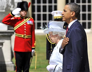 Barack Obama and Britain's Queen Elizabeth stand for the U.S. national anthem at Buckingham Palace