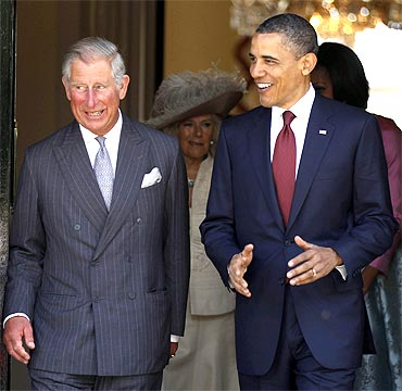 Obama walks with Prince Charles at the Winfield House in London